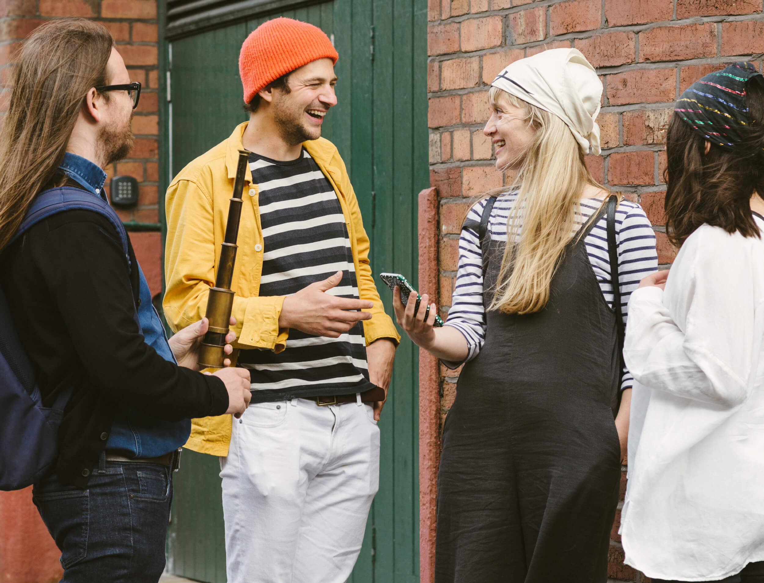 A group of friends exploring tourist attractions by playing Treasure Hunt Liverpool